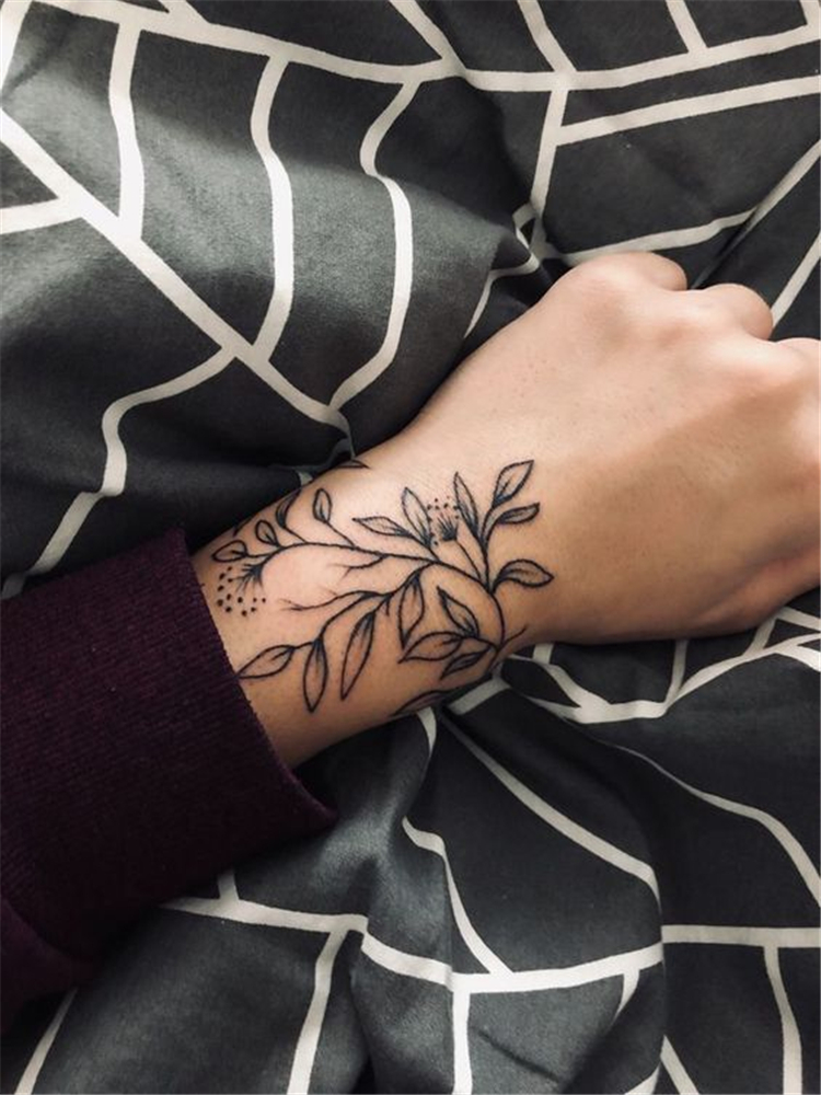 Meaningful Wrist Bracelet Floral Tattoo Designs You Would Love To Have; Floral Tattoo; Bracelet Floral Tattoo; Tattoo Designs; Tattoo Ideas; Flower Tattoo; Rose Tattoo; Small Floral Tattoo; #tattoo #tattooideas #floraltattoo #flowertattoo #rosetattoo #rose #chictattoo